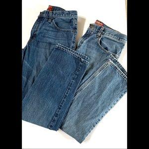 Two Medium and dark wash straight leg blue jeans
